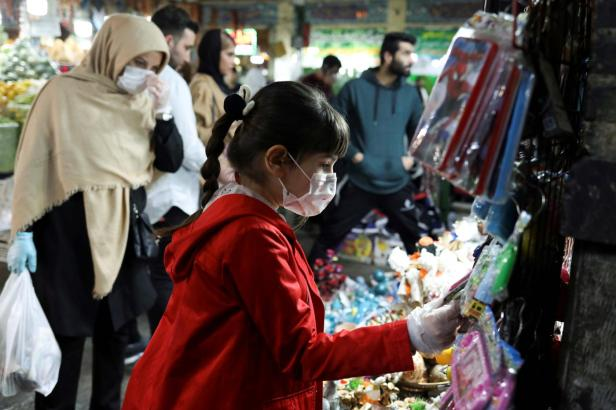 girl_wearing_mask_tehran_reuters
